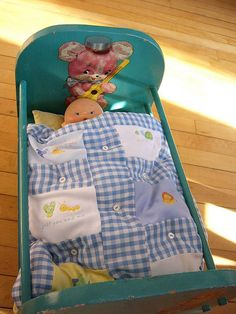 A vintage cool/creepy doll bed I picked up from treasure mart. I loved the decals immediately. I made a small mattress & quilt to make baby doll cozy. The quilt squares are from old onsies I couldn't bare to toss.     . Lovely item, Check these out :  http://adriankmarketing.com/products/?cat=24