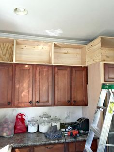 adding cabinets above cabinets Kitchen Redo, Decorating Above Kitchen Cabinets, Above Cabinet Decor, Kitchen Facelift, Kitchen Cabinet Makeovers, Kitchen Upgrades, Kitchen Cabinet Remodel, Diy Kitchen Remodel, Building Cabinets