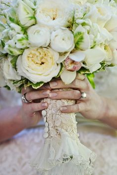This is what I want to do with mom's old lace!   Gorgeous bouquet wrap! The sleeve from her mother's gown ... via http://StyleMePretty.com/georgia-weddings/2012/04/16/atlanta-wedding-at-barnsley-gardens-resort-by-nadia-d-photography/ Photography by nadiadphoto.com, Floral Design by edgedesignatlanta.com