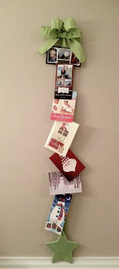 My Christmas Card Display - With a 3M hook, wire ribbon, floral ribbon, wood star and paper clips! I love it!