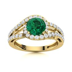This Emerald ring in 14k Yellow Gold with a dash of royalty and elegance has been laced with precious diamonds. An enticing ring to highlight the splendor of your magnificent center stone. Natural Emerald Rings, 3 Carat, Love Ring, Halo Rings, Halo Diamond, Shades Of Green, Vintage Rings, Ring Designs, Highlight