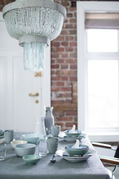 Table setting for winter in kitchen with exposed bricks Photo/styling: Marianne de Bourg