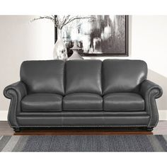 The Kassidy grey leather sofa features rolled arms and generously stuffed cushions to create an inviting atmosphere in your contemporary living room. Upholstered in a cool grey leather with white cont Grey Leather Sofa, Love Seat, Beautiful Sofas, Furniture, Sofa, Abbyson Living, Sofa Deals, Gray Sofa, Living Room Grey