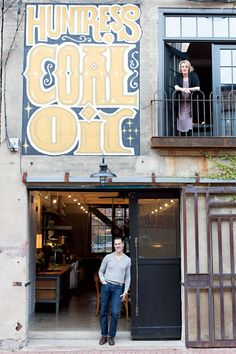 The Kahoes at their home's alley-side entrance, which opens onto their dining space. (Photo Credit: Patricia Lyons)