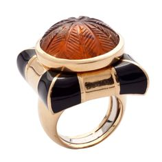 David Webb gold and black enamel ring set with amber | From a unique collection of vintage cocktail rings at https://www.1stdibs.com/jewelry/rings/cocktail-rings/