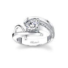 #1  This modern unique engagement ring has a white gold by pass shank that curves around the prong set diamond center. One shoulder is accented with pave set diamonds decorating the inside wall, while the other shoulder has a round wire trim rising from the bottom of the shank and meeting at the top. Available in two-tone, 18k or platinum.