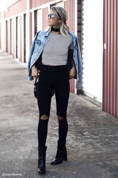 A pair of sculpted high-waisted skinny jeans with a zip fly, ripped detailing on the knees, and a five-pocket construction.