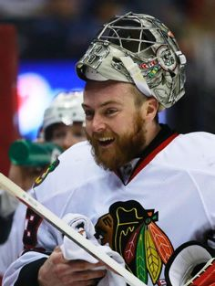 Chicago Blackhawks goalie Scott Darling smiles at the bench during the first period of an NHL hockey game against the Colorado Avalanche Saturday, April 11, 2015, in Denver. (AP Photo/Jack Dempsey)