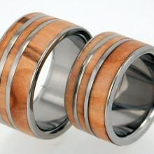 Roman Wood band set with inlays and titanium pinstripes. The designer uses all recycled metals and gemstones. | Green Bride Guide