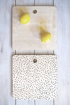 Madart Inc. Tropical Fusion 17 Watermelon Seeds Cutting Board Square | DENY Designs Home Accessories