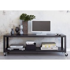 go-cart carbon grey two-shelf table-media cart in storage | CB2
