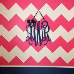 Coral Chevron Accent Wall with Monogram - so preppy! #nursery