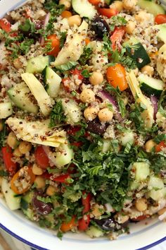 This crowd-pleasing Mediterranean Quinoa Salad is loaded with quinoa, cucumbers, tomatoes, purple onion, red bell peppers,artichoke hearts, kalamata olives and lots of fresh basil. It makes a delicious light lunch or side salad to serve at barbecues and potlucks.  This healthy Mediterranean Quinoa Salad embodies fresh Mediterranean flavors including garbanzo beans,cucumbers, tomatoes, purple onion, …