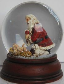 Santa kneeling at The Manger Christmas Snow Globes, Christmas Time, Santa Snow Globe, Plant In Glass, I Love Snow, Water Globes, Merry And Bright, Christmas Inspiration, Favorite Holiday