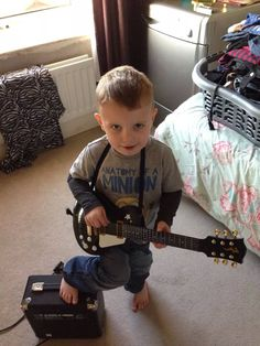 My boy joining me for a jam ha ha bless him got his foot up on practice amp as well . He's got the moves