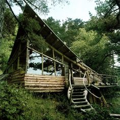 Gotta love this funky, organic, natural, homemade house. Love the windows, the deck railing and the swoop of the roof line. And the woodsy setting, of course.