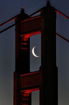 Golden Gate Bridge and crescent moon