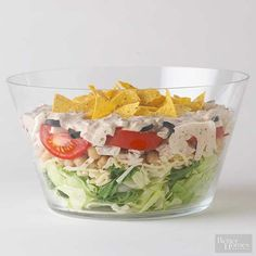 Layers of greens, turkey, tomatoes, jicama, cheese, and beans topped with tortilla chips and served with a chili dressing make a texturally interesting Mexican-inspired turkey salad. Layer the ingredients in the evening and chill overnight. Open the fridge come dinnertime and voila! You've got yourself a beautiful and filling meal.