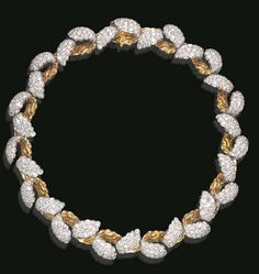 """A DIAMOND """"CLOUD"""" NECKLACE, BY TIFFANY & CO.  Designed as a series of flexible alternating pavé-set diamond and polished gold openwork links, mounted in platinum and 18k gold, 15 ins., circa 1989, in a Tiffany & Co. black suede case Signed Tiffany & Co., no. 10777881"""