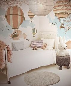This lovely air balloon wallpaper promotes a child's imagination to run wild in this cute bedroom!
