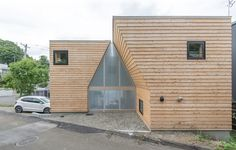 a gabled volume serves as an internal courtyard and with its greenhouse effect,  a warm space is created for the family during hokkaido's harsh winters.