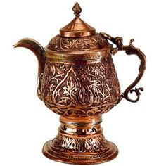 """This Kashmiri copper kettle""""samovars""""(tea kettle of Russian origin) is engraved with designs of the leaves of Chinar (maple) trees, native to Kashmir, India."""