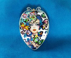 Girl with butterflies.  necklaces pendant-brooch.  cloisonne