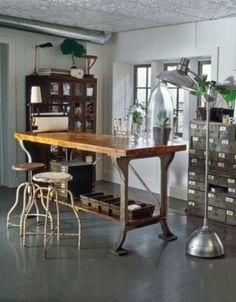 metal & wood table? check. table top specimen bell jars? check oversized standing lamp? check.