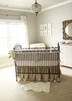 nursery in neutral tones that has the perfect mix of vintage, rustic, and classic pieces