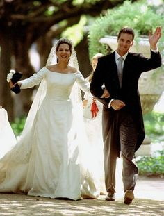 Spain's Princess Cristina and her new husband Inaki Urdangarin stroll along the gardens of Barcelona's Pedralbes Palace following their wedding at Barcelona's cathedral Saturday, October 4, 1997.