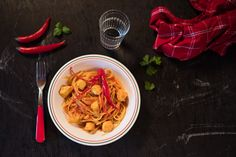 Tunisian pasta with chicken in spicy tomato sauce