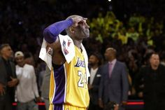 Los Angeles Lakers' Kobe Bryant solutes as he acknowledges fans after the last NBA basketball game of his career, against the Utah Jazz on Wednesday, April ...