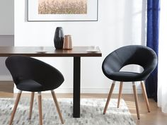 Skandynawski design i klasyczna kolorystyka. To piękne i wygodne krzesło sprawdzi się w każdym salonie i jadalni. #beliani #krzesło #wnętrza