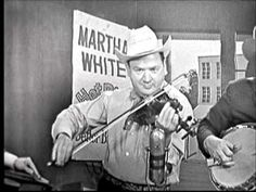 """June 19, 1914: Born, Lester Flatt. Guitarist/singer Lester Flatt, along with banjo player Earl Scruggs, founded the Foggy Mountain Boys, considered one of the best bluegrass bands of all time. Here Flatt and Scruggs are seen performing the """"Salty Dog Blues."""" They're probably better known for """"The Ballad of Jed Clampett"""" (from the """"Beverly Hillbillies"""" and """"Foggy Mountain Breakdown"""" (used in many cinema rural chase scenes, including """"Bonnie and Clyde"""" and Monty Python's """"Killer Sheep""""…"""