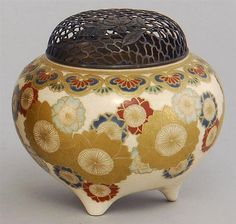 "Lot 250: SATSUMA POTTERY CENSER In ovoid form with floral decoration. Pierced silver cover. Diameter 4"". - Eldred's 