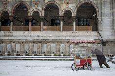 A street vendor pushes his cart through the snow after a heavy snow storm on December 31, 2015 in Istanbul, Turkey. The city has prepared more than 1000 snow clearing vehicles and heavy machinery ready to clear streets and transport systems. The severe snow storm is expected to continue through until January 2nd and has disrupted travel plans with Turkish airlines yesterday cancelling 142 flights and more disruptions are expected over the coming days.