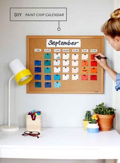 Pin paint chips to a cork board to make a colorful and cheap calendar.