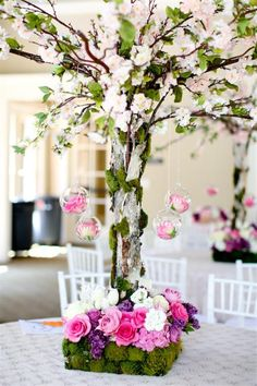 For an outdoor wedding reception. Love the flowering branches, moss and the pink flowers!