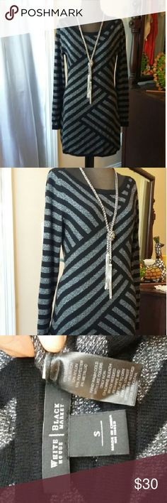 WHBM Sweater Dress Gorgeous sweater dress by White House Black Market. Black and silver, long sleeves. 57% cotton, 15% rayon, 12% nylon, 10% polyester, 6% metallic. Very soft, slightly fitted. Dress it up or down for many occasions. Gently used, great condition. White House Black Market Dresses Long Sleeve