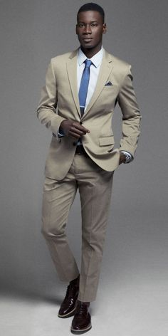 A light khaki suit is a spring wardrobe staple that will easily carry over through summer. #Express #mensfashion