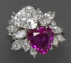 Pink sapphire and diamond ring set in platinum.