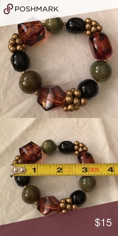Beautiful stretch bracelet in natural colors. Awesome stretch bracelet with Amber, green, black and gold beads. Jewelry Bracelets