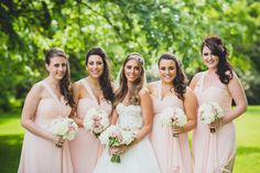 Soft pink bridesmaid dresses with shoulder strap detail and pleated bust.  Bouquets by Red Floral Architecture.  Photo by tobiah tayo photography -  available for commissions worldwide  www.tobiahtayo.com