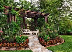 Pergola and evergreens create a perfect garden roo...