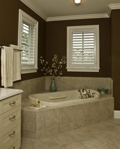 dark bathroom walls & angled tub. just like mine, only prettier...