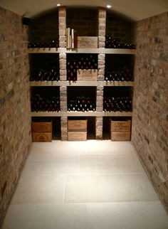 Jerusalem Antique gold large format tiles in tumbled finish was chosen to complement the brick shelves and showcase a carefully curated wine collection
