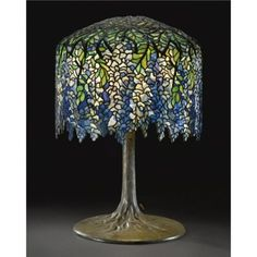 Art Nouveau Style Blue Wisteria Lamp with Bronze Tree Trunk Lamp Base by Tiffany Studios, New York