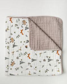 Little unicorn forest friends quilt ( Google: little unicorn baby quilts)
