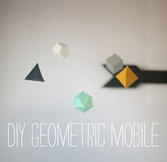 When I was dreaming about baby stuff and what would go in his room and all that fun stuff, I was eyeing some really fun geometric baby mob...