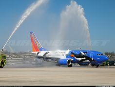 "Airliners.net ‏- Sothwests new ""Penguin One' receiving a water salute upon arrival at SAN"